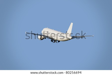 airplane taking-off in a blue sky - stock photo