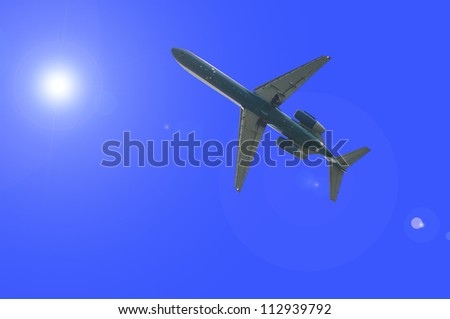airplane through the sunlight - stock photo