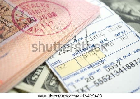 airplane ticket and passport on american dollars - stock photo