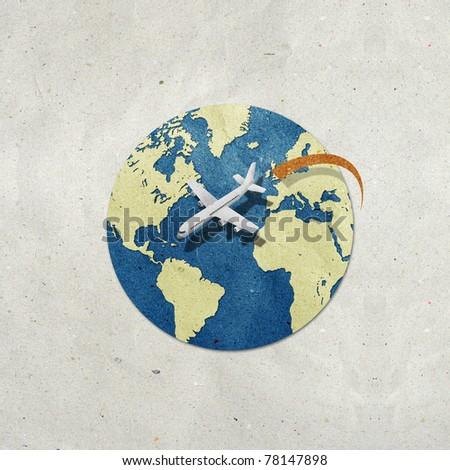 airplane travel around the globe recycled paper craft : Data source: NASA - stock photo