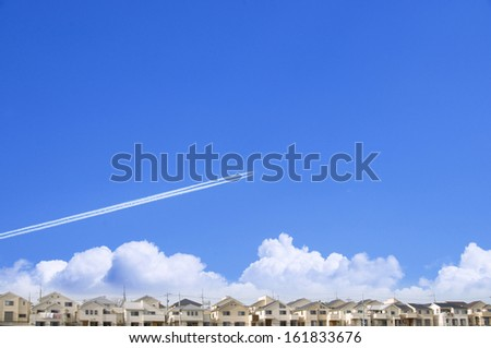 Airplane vapor trails in blue sky - stock photo