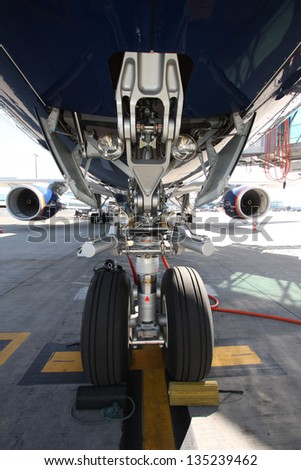 Airplane view from landing gear - stock photo