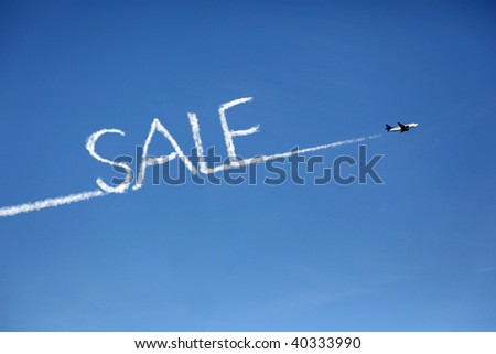 airplane who's exhaust pipes form the word sale as a cloud - stock photo