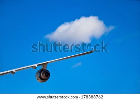 Airplane wind and turbine with a single white cloud - stock photo