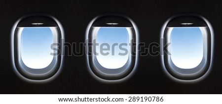 airplane window and Fantastic soft white clouds against blue sky. - stock photo