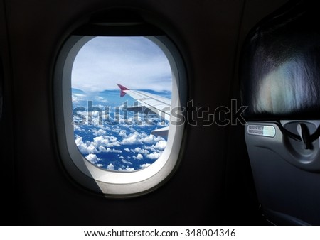 Airplane window seat with view - stock photo