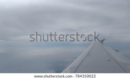 Airplane wing and sky view