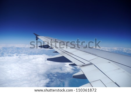 airplane wing in the sky - stock photo