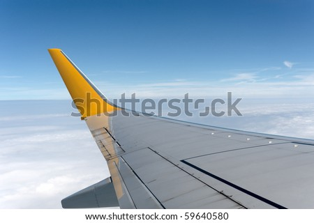 airplane wings in the blue clouds