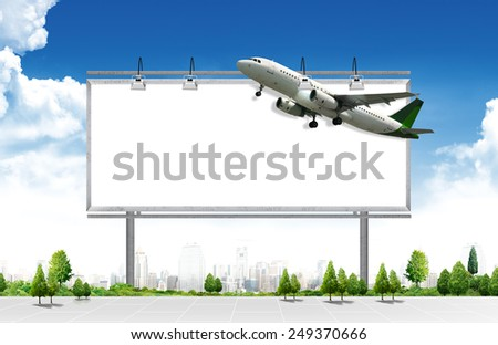 Airplane with blank billboard, travel andvertisement  - stock photo
