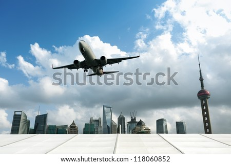airplane with modern city in shanghai, China. - stock photo