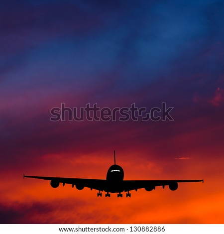 Airplane with Sunset. - stock photo