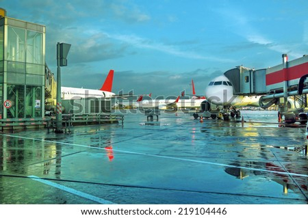 Airplanes at the airport on loading - stock photo
