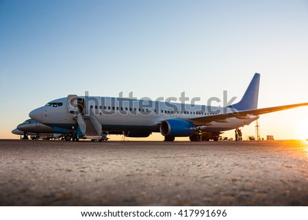 Airplanes in the morning the airport apron - stock photo