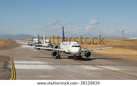 airplanes lined up for take off - stock photo
