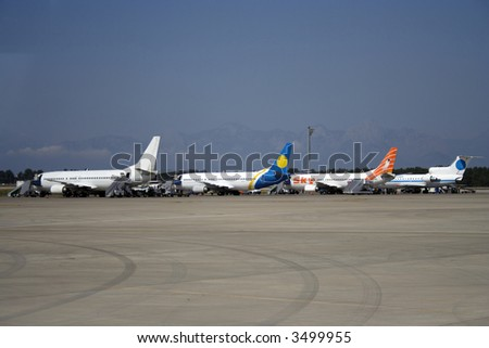 airplanes on a runway of international airport terminal