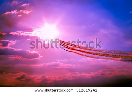 Airplanes on airshow. Aerobatic team performs flight at air show. - stock photo