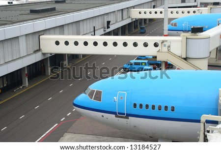 Airplanes parked at the gates to the airfield terminal - stock photo