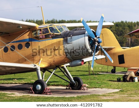 Airplanes standing on green gras. Two old yellow biplane in a retro style. Yellow aircraft.