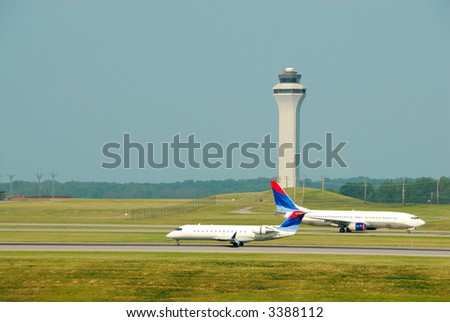 Airplanes Taking Off and Landing In Front Of The Control Tower - Cincinnati Northern KY International Airport, CVG - stock photo