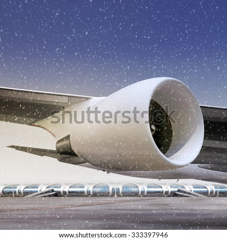 airport and turbine of plane at non-flying weather, winter time - stock photo