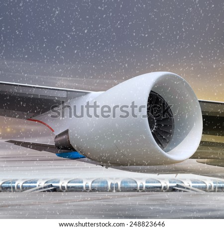 airport and white plane at non-flying weather, winter time - stock photo