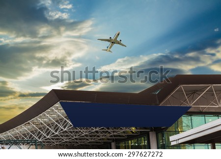 Airport at sunset with an airplane taking off