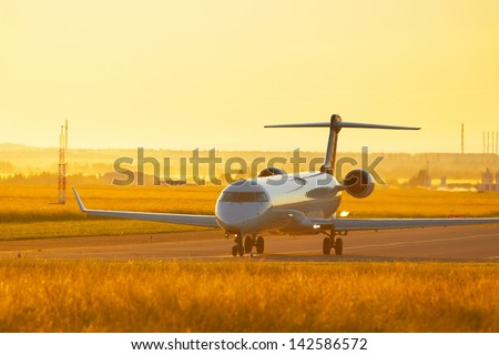 Airport at the sunset - airplane before take off - stock photo