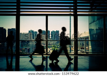 Airport channel walking tourists - stock photo