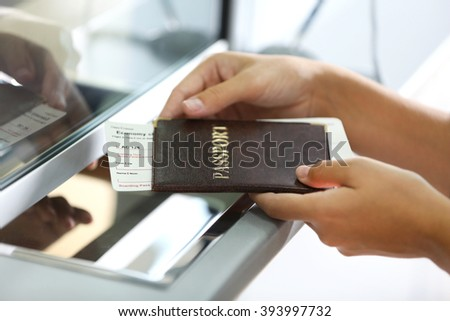 Airport Check-In Counters With Passengers  - stock photo