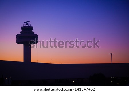 Airport Control Tower at a Beautiful Sunset - stock photo