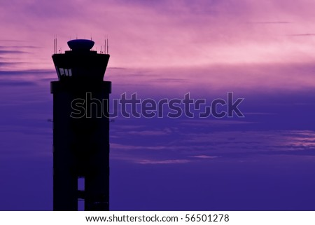 Airport Control Tower Silhouette Against Sky - stock photo