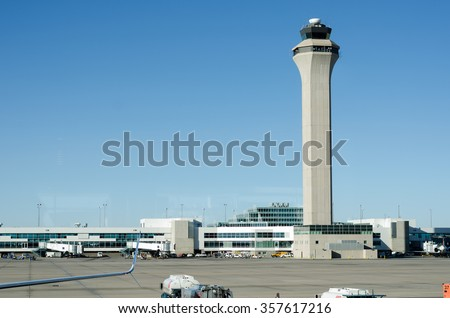 Airport control tower with clear skys - stock photo