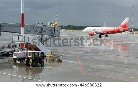 airport in the rain - stock photo