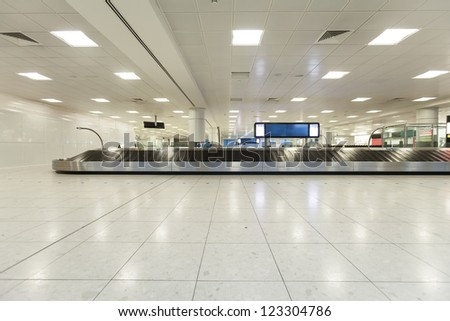 airport interior at baggage claim - stock photo