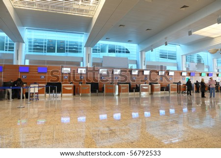 airport interior hall with reflection on floor general view - stock photo