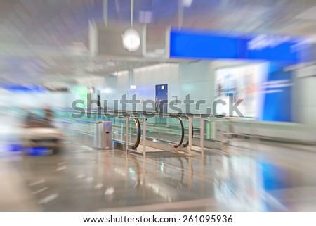 Airport interior with escalator. Motion blur. - stock photo