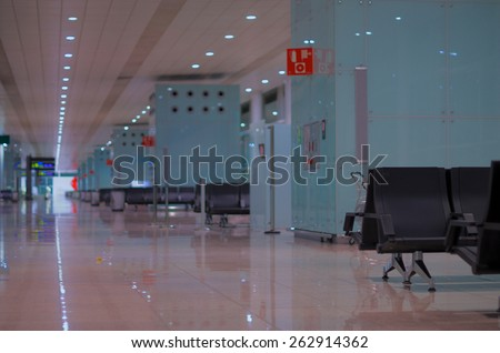 Airport Lounge Zone with Black Chairs. Focus on Foreground - stock photo