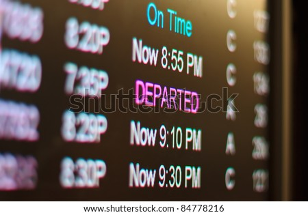 airport monitor with different air traffic words signalling the state of a certain flight. - stock photo