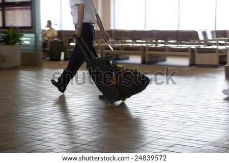 Airport rush blur  legs male - stock photo