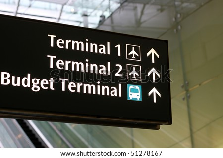 Airport sign for terminal directions - stock photo