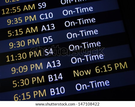 Airport signage alerting passengers of a delay - stock photo