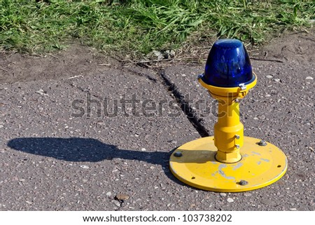 airport taxiway edge lighting - stock photo