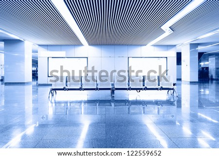 Airport terminal area empty chair, billboard - stock photo
