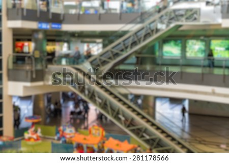 airport terminal area with escalator blur background