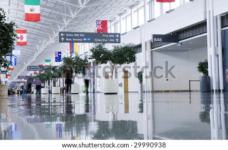 Airport Terminal blurred people - stock photo