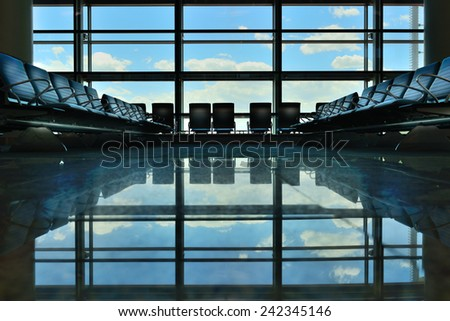 Airport terminal gate waiting area - stock photo