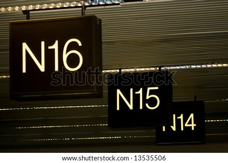 Airport Terminal Gates N are direction signs to airline travelers for departing or arriving flights. Also baggage claim uses gate numbers to pick up your bags. - stock photo
