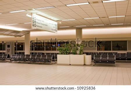 Airport terminal interior with gates and waiting area