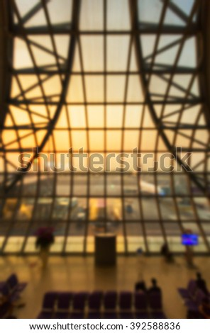 Airport terminal with airplane blurred background - stock photo